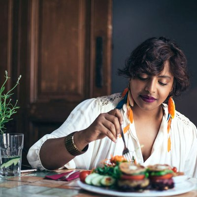 Woman eating meal in a restaurant