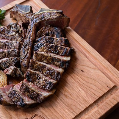 sliced steak on cutting board