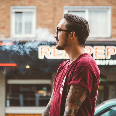 man smoking on the street