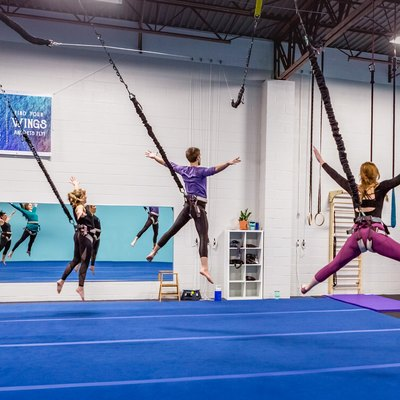 group of people in a gymnasium doing a bungee workout