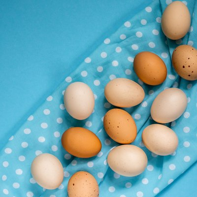 Eggs on a blue background, close-up.