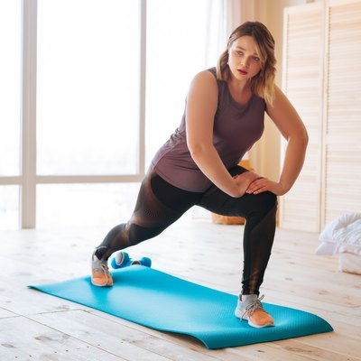 Woman doing her weight-loss exercise at home