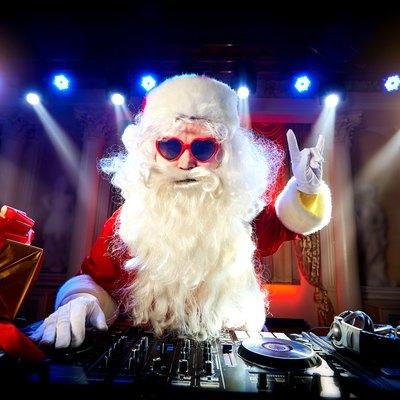 Dj Santa Claus mixing at the party Christmas