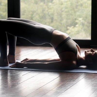 Young sporty woman doing dvi pada pithasana exercise