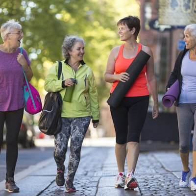 Woman taking a walk together to get the benefits of walking