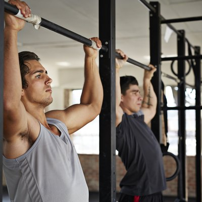 Men doing pull-up's at gym gym