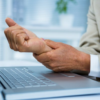 Businessman with wrist pain