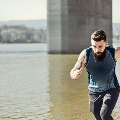 man running outdoors along a river in a virtual race