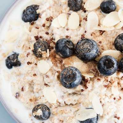 Close view of quinoa oatmeal with almond milk, blueberries and slivered almonds