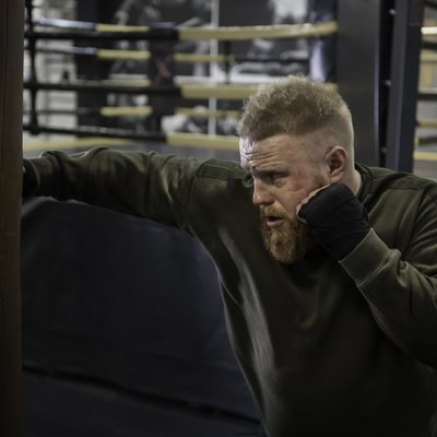 MMA Fighter Practicing With Boxing Bag.