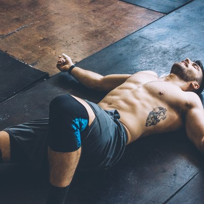 Man lying on the floor after leg day workout