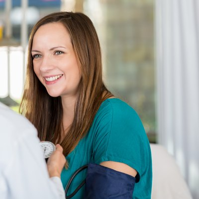 Happy pregnant woman during medical exam