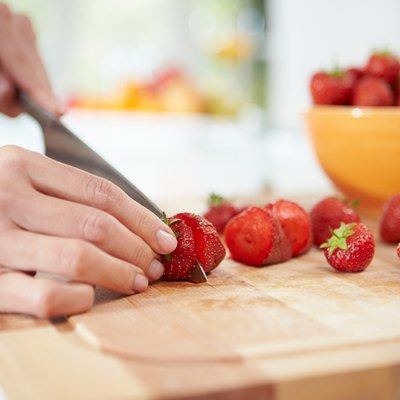 Close Up Of Woman Preparing Fruit Salad