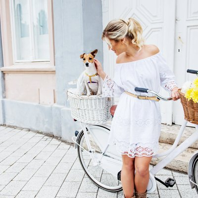Beautiful, blond woman riding a bicycle in a town