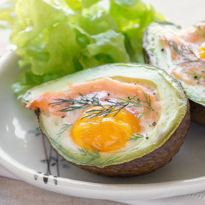 Baked smoked salmon, egg in avodaco, ketogenic keto low-carb diet food