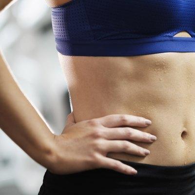 Sweating midriff of Mixed Race woman
