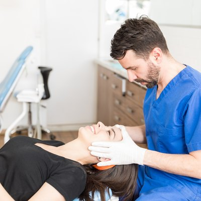woman laying down in dermatologist office