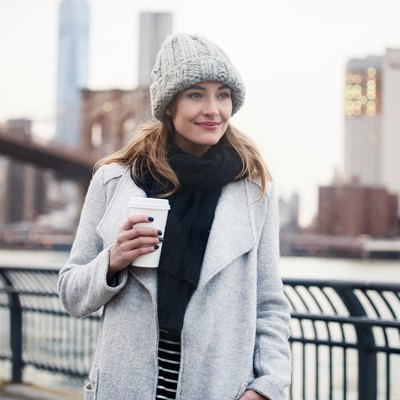 Beautiful woman walking with coffee cup in New York City