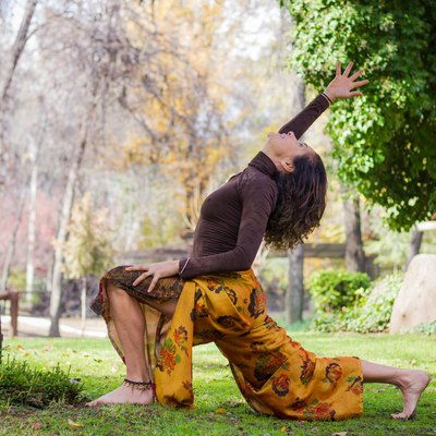 Woman practices yoga in the park
