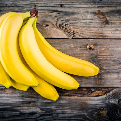 Bunch of raw organic banana on wooden background