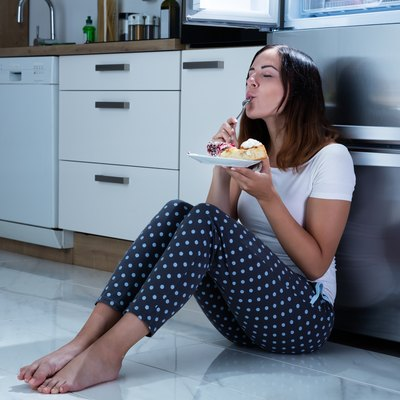Woman Enjoy Eating Sweet Food In Kitchen