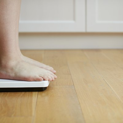 Woman standing on weighing scales