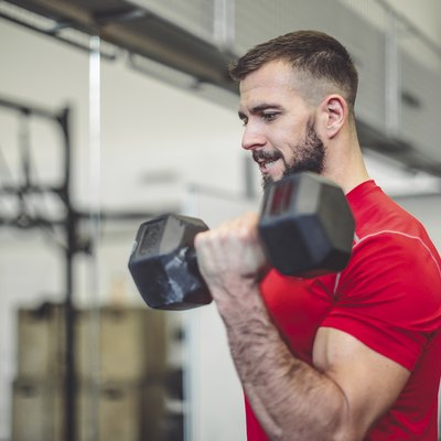Strong man is doing cross training exercise