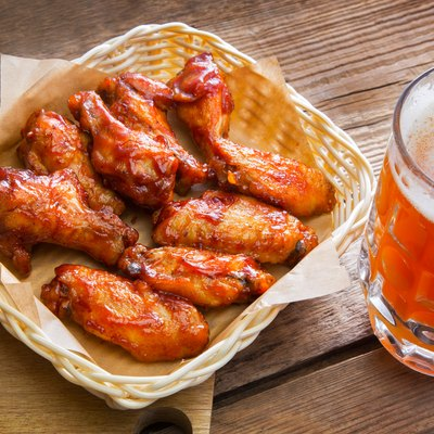 Fried chicken wings and a large mug of beer