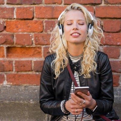 Woman enjoying peaceful music on her headphones