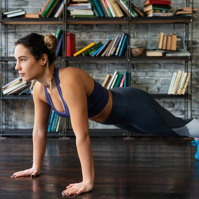 Woman doing push-ups during at-home CrossFit workout