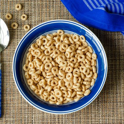 Bowl of cereal with spoon and blue napkin