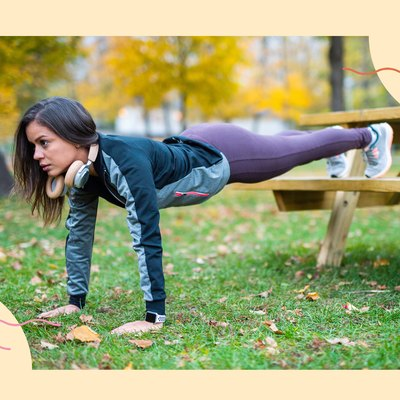 woman doing decline push-up variation on picnic table bench outside