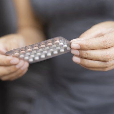 Midsection of Woman Holding Pack of birth control pills for pcos treatment