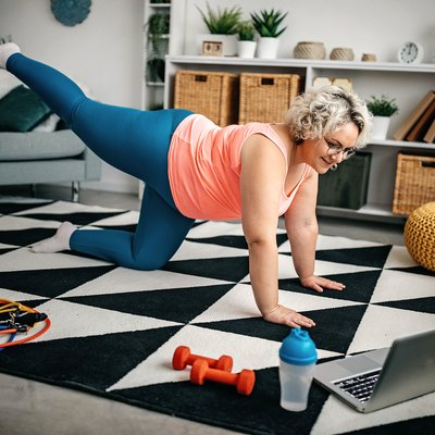 woman doing a low-impact butt and leg workout at home