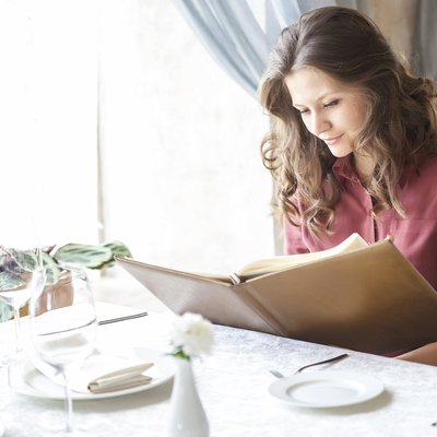 Woman in a restaurant with the menu