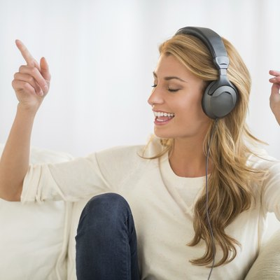 Woman Enjoying Music Through Headphones