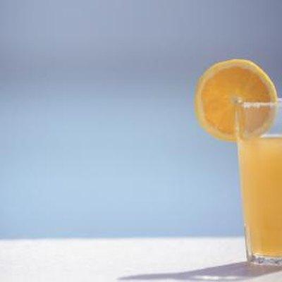 Orange juice, an orange slice, garnish