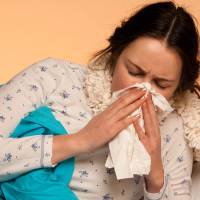 Asian caucasian woman with flu  and fever