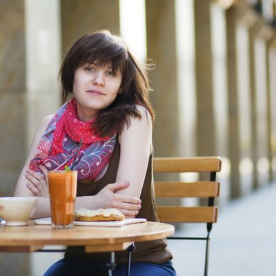 Young girl having breakfast in a cafe