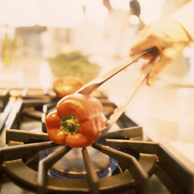 Charring bell pepper over gas flame