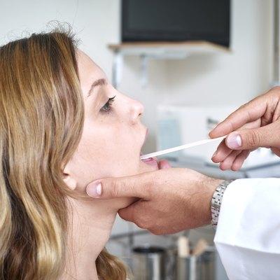 Woman having a throat examination