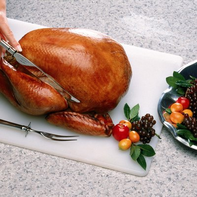 Person carving turkey