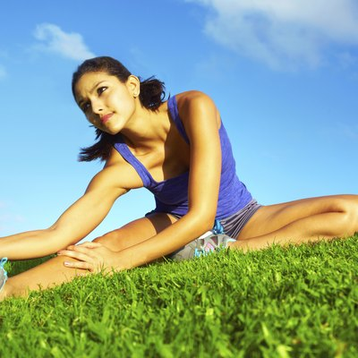 Healthy Young Pretty Mixed Race Woman Stretching Her Leg