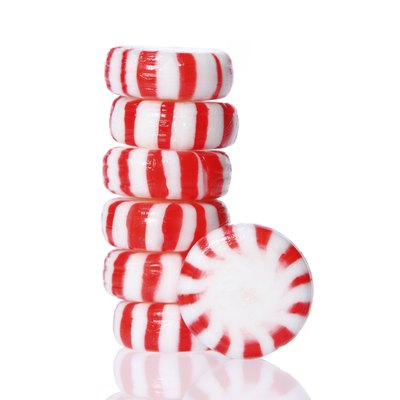 Peppermint candy tower isolated, macro.