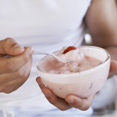 Hands holding yogurt