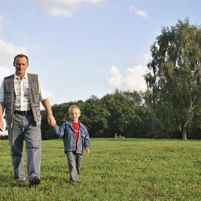 grandfather and boy walking
