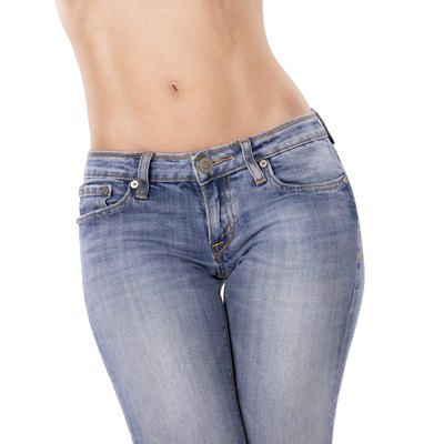 Attractive slim fit woman in blue jeans.