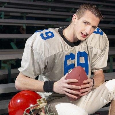 Football player in bleachers