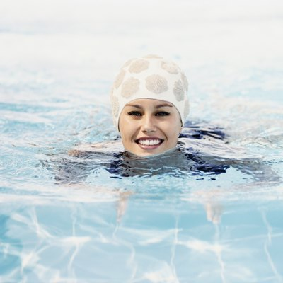 Portrait of a Young Woman Swimming in a Pool