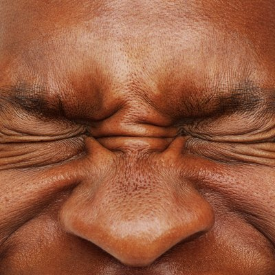 close-up of a man's eyes shut tight